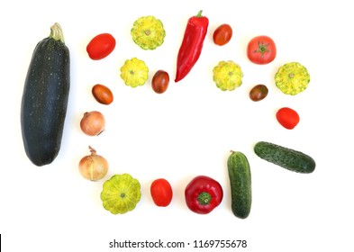Fresh vegetables on a white background. Round composition of cucumber, tomato, onion, red pepper, zucchini, squash.
