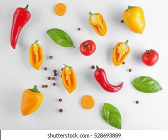 Fresh vegetables on white background, top view