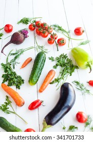 Fresh vegetables on white table, selective focus on tomato cherry