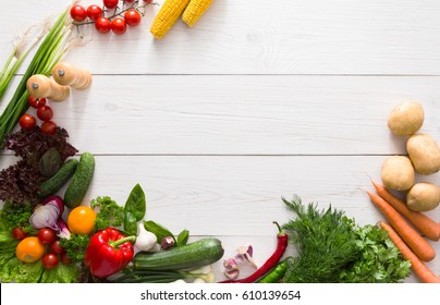 Fresh vegetables on white wood background. Mockup for menu or recipe