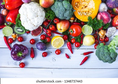 Fresh vegetables on a wooden background. Healthy food.