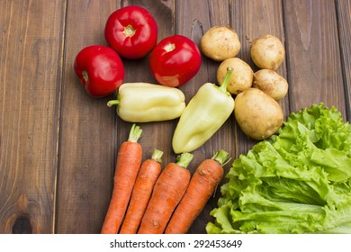 Fresh vegetables on a wooden background in garden