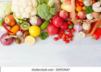 Fresh vegetables on a wooden background. Top view.