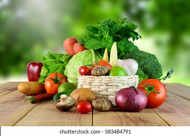 Fresh vegetables on wooden and blur background.