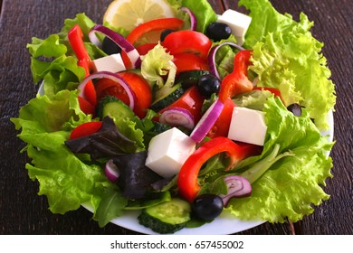 Fresh vegetables on wooden and blur background