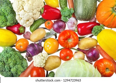 Fresh vegetables. Plant-based food:cucumbers, tomatoes, broccoli, cabbage, peppers, kohlrabi, onions, garlic, zucchini, potatoes, carrots and pumpkins on a white background.
