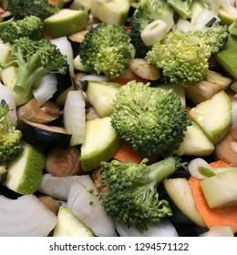 Fresh vegetables in plate - broccoli, zucchini, onion, eggplant, carrot