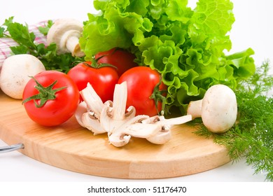 Fresh vegetables for the salad on a white background