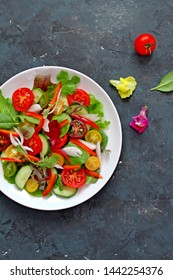 Fresh vegetables salad. Top view with copy space. Healthy food concept.