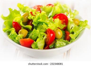 Fresh  vegetables salad in  white bowl. Selective focus