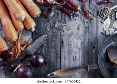 fresh vegetables and spices on gray wooden surface, pan frying, top view