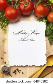 fresh vegetables and spices on the  wooden background and paper for notes