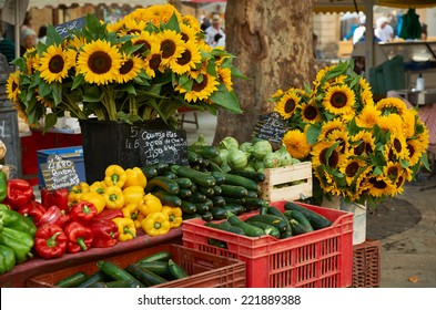 Fresh vegetables and sunflower blossoms for sale at farmers market in Aiv en Provence, France