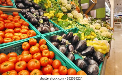 Fresh Vegetables, Tomato, Purple Eggplant, Lemon, on Shelf in Supermarket