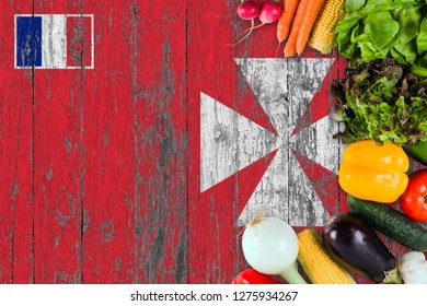 Fresh vegetables from Wallis And Futuna on table. Cooking concept on wooden flag background.