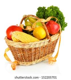Fresh vegetables in wicker basket isolated on white