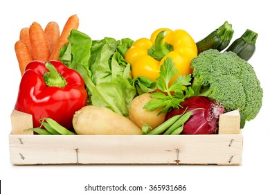 fresh vegetables in a wooden box isolated on white