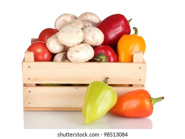 fresh vegetables in wooden box isolated on white