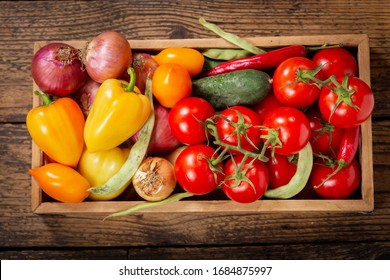 fresh vegetables in a wooden box, top view