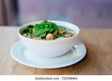 Fresh vietnamese pho soup in dish on wooden table
