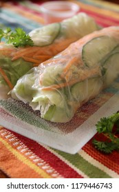 Fresh Vietnamese  rolls wrapped in rice paper filled with vegetables and peanuts with spicy Asian sauce for dipping