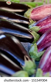 fresh violet eggplant in summer outdoor on market macro closeup