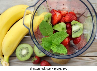 Fresh vivid smoothie ingredients and blender