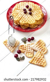 Fresh waffles in the shape of heart