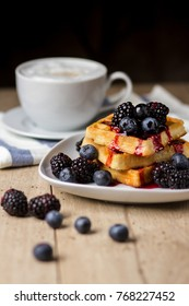Fresh waffles with syrup and berries
