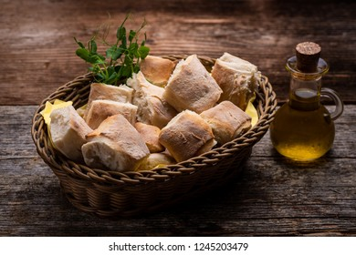 Fresh warm baked bread on old wooden table