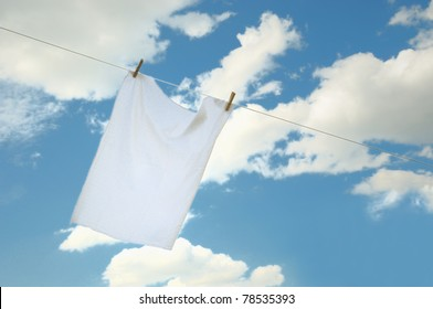 Fresh washed kitchen white towel drying on the wind in cloudy day