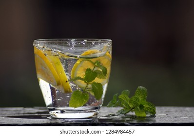 Fresh water in the glass with lemon and mint
