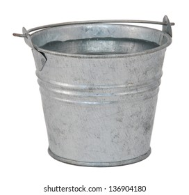 Fresh water in a miniature metal bucket, isolated on a white background