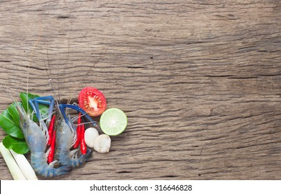 fresh water prawn with ingredient on wood background