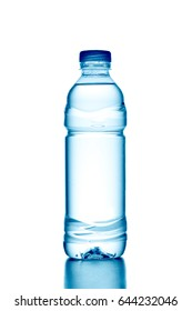 Fresh water splashing out of bottle, isolated on white background