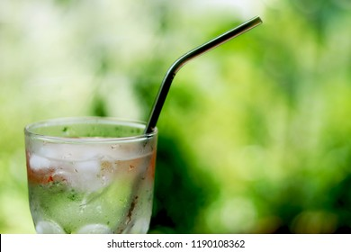 Fresh water with stainless steel drink straw. Concept for reduce plastic pollution and support green eco friendly products. selective focus