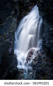 Fresh waterfall between the cliffs. Rondane mountains, Norway