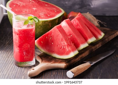 Fresh watermelon juice with ice in a glass. Slices of watermelon on the table.Fresh watermelon juice with ice in a glass. Slices of watermelon on the table. - Shutterstock ID 1991643737