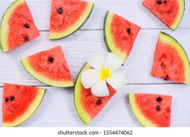 Fresh watermelon slice texture background / Watermelon seamless summer fruit and white flower , top view