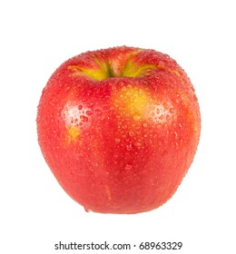 A fresh and wet Honeycrisp apple isolated on a white background.
