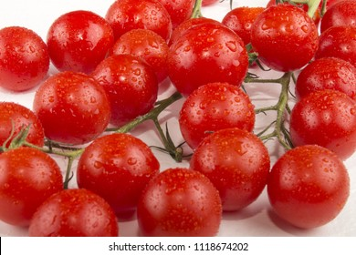 fresh and wet organic piccolo tomatoes on bright background