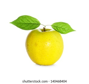 fresh and wet yellow apple with green leaf with water and with drops isolated on a white background