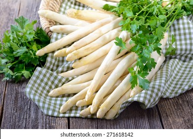 Fresh white asparagus of Germany - Bavaria on a wooden table