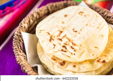 Fresh white corn tortillas in the basket.