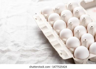 Fresh white eggs in paper box