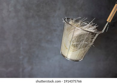 Fresh white rice Noodle Blanched in colander for cooking , Can be used as a background