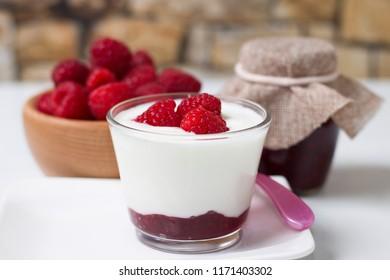 Fresh white yogurt with raspberries