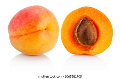 Fresh whole apricot fruit and half isolated on white background
