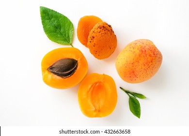 Fresh whole apricot, sliced fruit and dry apricot with leaves isolated.