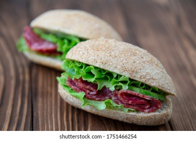 Fresh whole grain sandwiches with salami and lettuce
